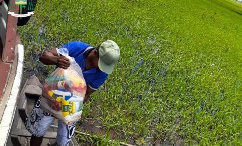 Igreja vai até as comunidades ribeiras entregar cestas básicas   Portal Obidense